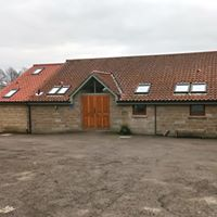 Photograph of village hall seen from the car park.